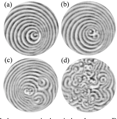 Fig. 8 The development of spiral turbulence as a single spiral undergoes a Doppler instability: (a) t = 0, a pair of defects is just generated; (b) t = 100 s, new defects self-organize into spirals; (c) t = 400 s, daughter spirals give birth to granddaughter spirals; (d) t = 2000 s, spiral turbulence. The control parameters are the same as in Fig. 7 (with 0.10 M malonic acid concentration). The region shown is 19.5 mm in diameter.