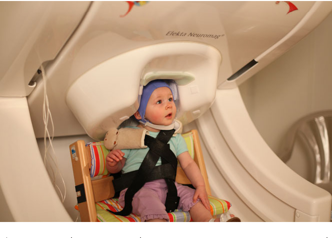 Figure 1 Infant in MEG during measurement. A custom-made adjustable chair  was used