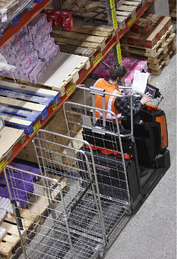 Figure 1: An order picker towing two empty bins. Image courtesy of Rocla.