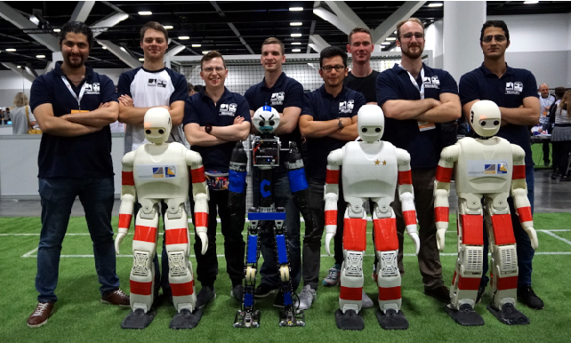 Figure 1 for RoboCup 2019 AdultSize Winner NimbRo: Deep Learning Perception, In-Walk Kick, Push Recovery, and Team Play Capabilities