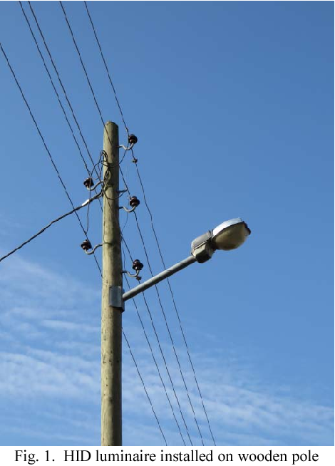 Fig. 1. HID luminaire installed on wooden pole