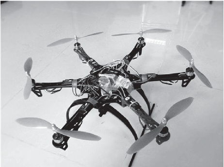 Figure 2 for Controllability Analysis and Degraded Control for a Class of Hexacopters Subject to Rotor Failures